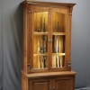 Gun cabinet with fly rod storage