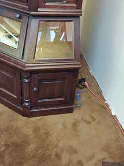 Corner Gun Cabinet Decorative Fluted Accents And Raised Panels