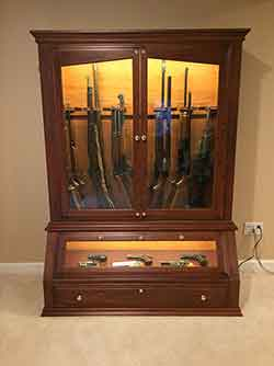 Chery Gun Cabinet With Side Display Of Rifles And Shotguns